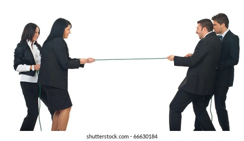 Two businesswomen and two  businessmen playing tug war  isolated on white background