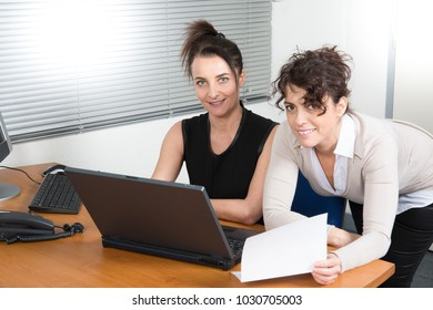 Two businesswomen discuss about business of company