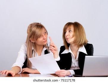 Two businesswomen having a meeting in office