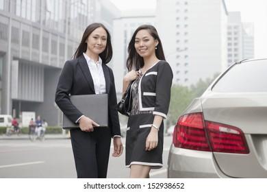 Two Businesswomen Standing On Road