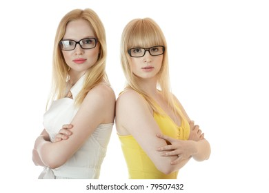 Two businesswomen standing together back to back isolated over white background