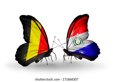 Two butterflies with flags on wings as symbol of relations Belgium and Paraguay
