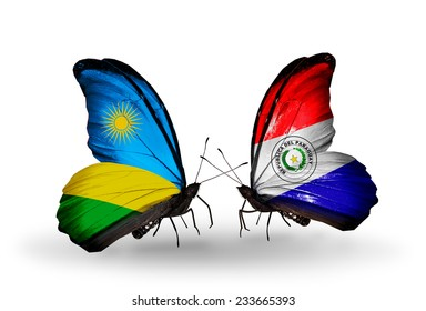 Two butterflies with flags on wings as symbol of relations Rwanda and Paraguay