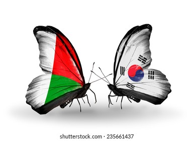 Two butterflies with flags on wings as symbol of relations Madagascar and South Korea