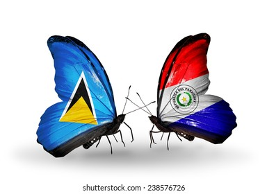 Two butterflies with flags on wings as symbol of relations Saint Lucia and Paraguay