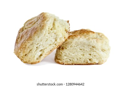 Two buttermilk southern biscuits or scones isolated over a white background with light shadow and clipping path..