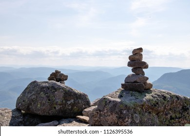 Two cairns (Inukshuk rocks) on top of a mountain in the Grands-Jardins National Park in the Charlevoix Region in Quebec, Canada.
