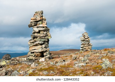 Two cairns on the top of a mountain
