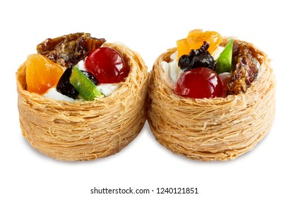 two cakes with fruits in a basket of dough kataifi isolated on white background