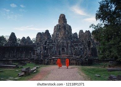 Two Cambodian monks entering the temple of Bayon