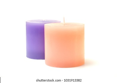 two candles pink and purple isolated on white background