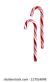 Two candy canes isolated on white background. Christmas, holiday concept. Space for copy. Useful as greeting card. Clipping path included.