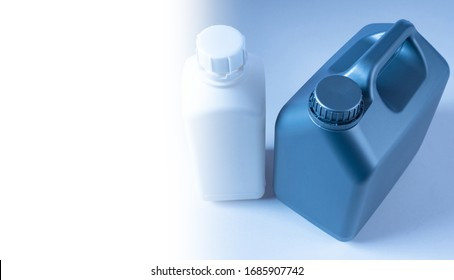 Two canisters stand nearby. Canisters without labels top view. Concept - sale of household chemicals. White space next to canisters. Place fhe test. Plastic utensils. Platik packaging without labels