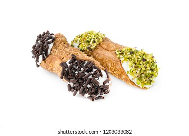 Two cannoli pastries. Traditional Sicilian dessert, filled with a rich ricotta cream  enriched with pistachio grain and chocolate flakes.