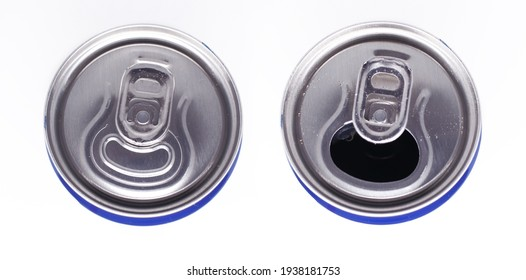 Two cans of juice. An open aluminum can and a closed aluminum can. Top view