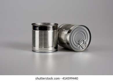 Two cans on a grey background isolated