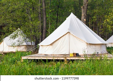 Two canvas bell tents outdoors at forest. Glamping at the forest