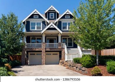 Two car garage Victorian Bungalow style single family home in North America suburban neighborhood