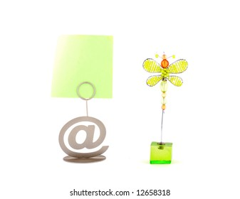 """two card holders: the """"at"""" sign and green butterfly over white"""