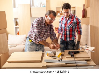 Ordinaire Two Carpenters Working At Location.Repairing Furniture.