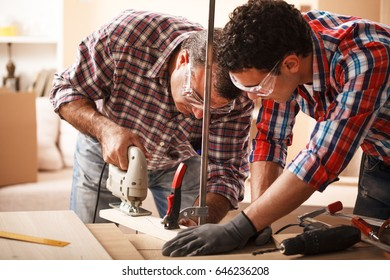 Two carpenters working on location.Repairing furniture.