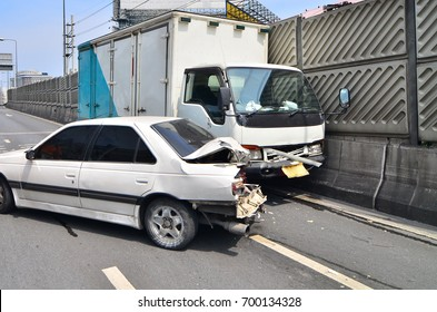 Two cars crash on the road