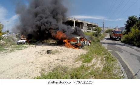Two cars explode and burn after rocket attack during drill called Northern Face. Some people injured. Firefighters are on the way to extinguish the fire, MIGDAL HAEMEK, ISRAEL, MARCH 23, 2015.