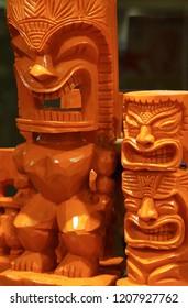 Two carved tiki gods