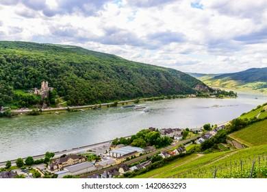 Two castles view, Castle burg Rheinstein and Reichenstein in the Upper Middle Rhine river valley (Mittelrhein), vineyards nearby Rudesheim am Rhein, Lorch. Hessen, Germany. Unesco