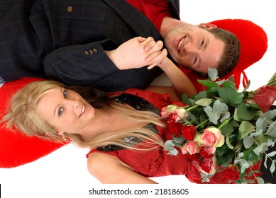 Two casual dressed young adults, teenage man and woman in love, embracing each other. studio shot,