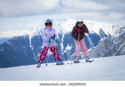 two caucasian girls skiing in the winter in the Dolomites Italy