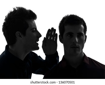 two caucasian young men gossip schyzophrenia concept  in shadow  white background