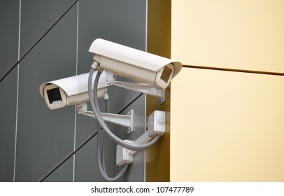 Two CCTV cameras on the cone of the morden building