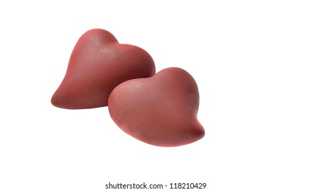 Two ceramic red hearts isolated on the white background.