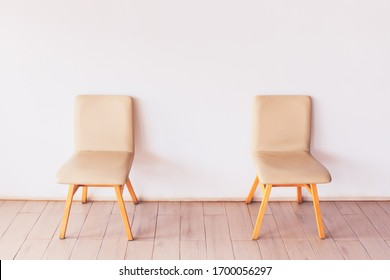 Two chairs in the coffee shop was setup with space from each others due to coronavirus issue and social distancing measure