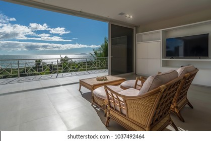 Two chairs facing the ocean in fancy living room