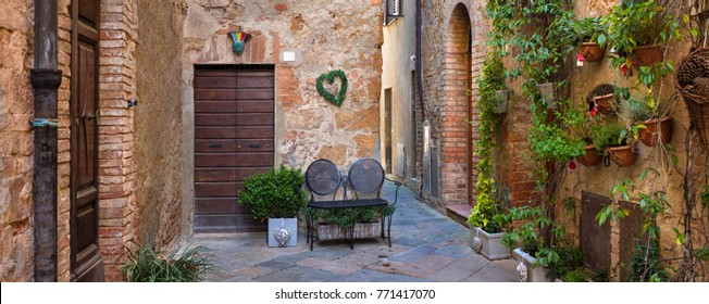 two chairs on the alone street in tuscany city in Italy