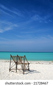two chairs on exotic beach