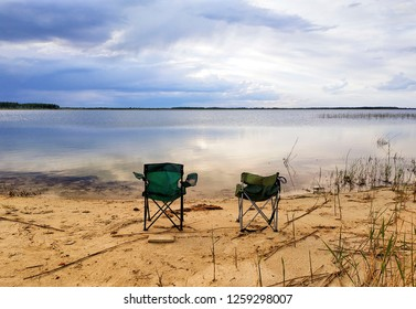 Two chairs on the lake