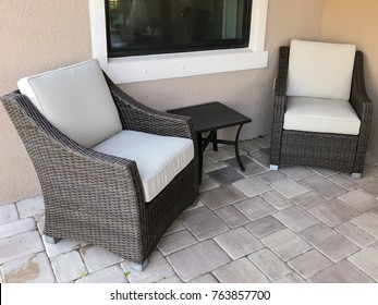 Two chairs on a stone outdoor patio