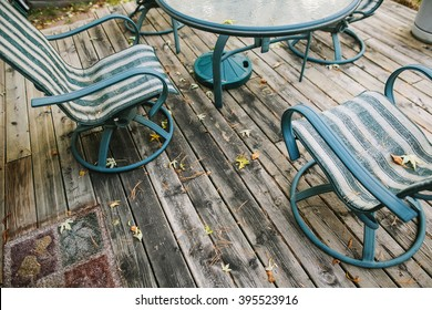 Two chairs on wooden porch at backyard in autumn