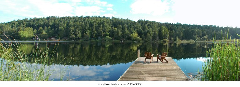 Two chairs overlooking Cushion lake, Salt Spring island, BC.