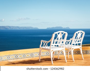 two chairs at a patio