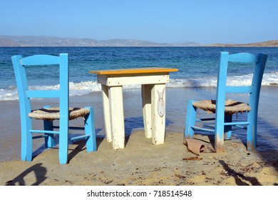 Two chairs and table by the sea in Greece