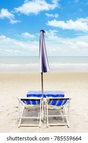 Two chairs and umbrella on beach