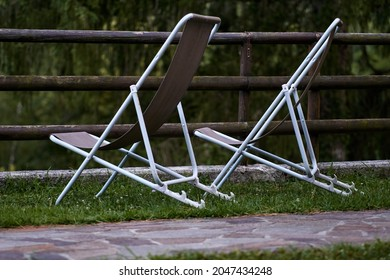 two chairs without people on a grass. High quality photo