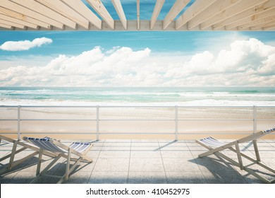 Two chaise longues under awning at the seaside. 3D Rendering