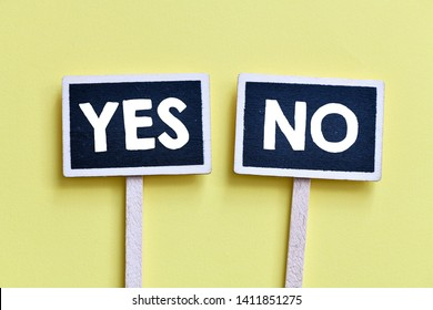 two chalkboards with yes and no answers