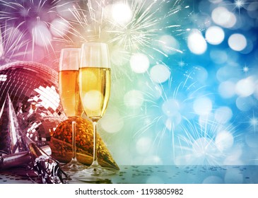 Two champagne glasses against New Year