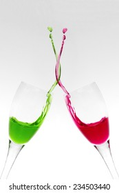 Two champagne glasses clinking and mixing liquids